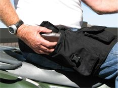 Accessing the large pocket is fairly easy to do while sitting. The top zipper-close pocket is hidden behind the flap in this photo, and is a little tougher to access while sitting.