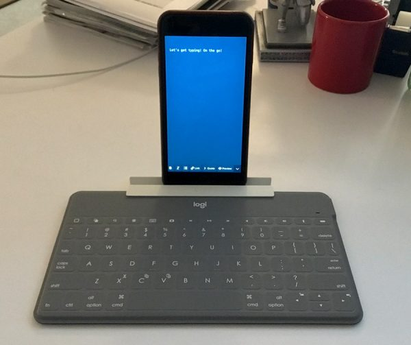 iPhone sitting in mobile phone stand